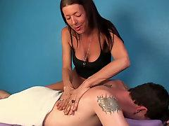 Mature masseuse tugging a cock for some tips