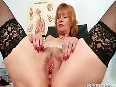 Redhead granny gets her pussy stretched out while being examined