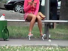 Upskirt on a bus bench with a beauty