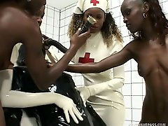Four ebony nurses get freaky with a bound gimp covered in latex