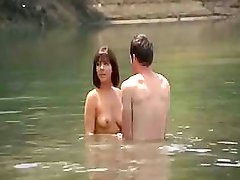Roxanne Pallet is swimming naked with a friend and sits on his dick