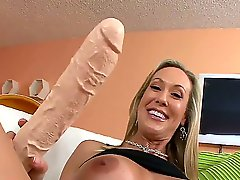 Arousing blonde milf Brandi Love with big tits teases and fingers her tight firm ass by the stripper pool