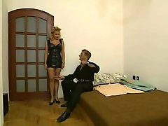 Milf strips from leather dress to have sex