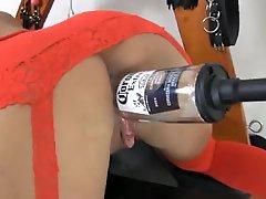 Bimbo does bottle fuck with a machine