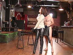 Masked slaves licks his mistress leather boots