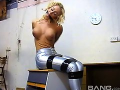 Fabulous blonde babe in a spandex outfit struggles with her binds in an epic bdsm fetish shoot