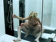 Cute blonde Riley Steele sucks and rides a cock in the shower