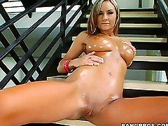 Oiled Amy Reid poses over the