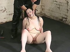 Long haired brunette gets her tits tied up and slapped....