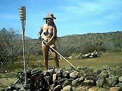 Nude female farm worker outdoor