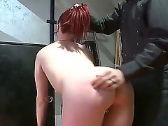 Hot master in black uniform and leather gloves spanks horny redheads pale butt