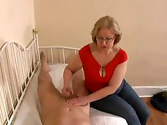 Mature blonde mom sends the bad boys to their room and jerks their cocks