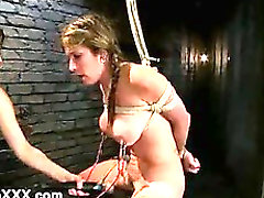 Electro shocked tied up busty babe by her mistress