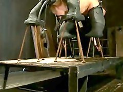 Sexy blond suffers through latex, caning, whipping, fire, orgasms,...