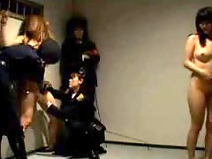 Police officers play with bound Japanese girl