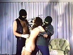 Kinky tied up vintage brunette girlie gets mouth fucked on the floor