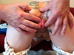 Tattooed girl gets a pussy massage