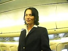 Short-haired brunette stewardess gets herself fucked by one of the passengers