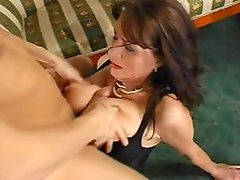 Busty brunette MILF eats his cock and then gets drilled hard