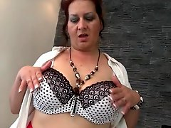 Sultry solo mature plays with her big natural tits