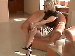 Sexy milf in blouse and stockings gives a footjob