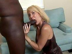 Mature blonde in dress sucks BBC