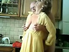 Mummy and daddy having fun in the kitchen. Stolen video
