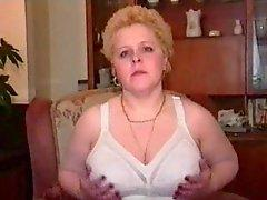 Girl in girdle strips down to it