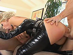 Leather Clad Fuck Slut Takes Two Pricks