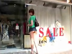 Japanese girl shopping in Tokyo in mini skirt