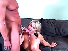 Mini-skirt clad cougar with huge tits enjoying a hardcore cowgirl style fuck