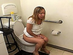Blonde Babe Sucks Cock on the Toilet