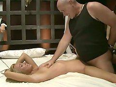 Slim blonde babe gets tied up and fucked on a bed