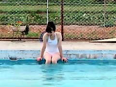 Cutie changes into her swimsuit and goes swimming