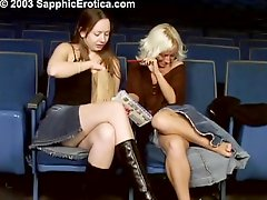 Two horny babes get naughty in the cinema