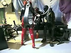Tied up girl in latex mask getting tortured by a dominant couple