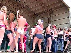 Drunk and chubby party girls dance on stage