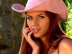 Sexy cowgirl goes outdoor stripping
