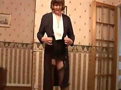 Attractive granny in Panty Hose and girdle shows off hairy cunt
