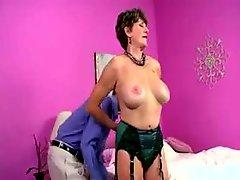 Mature in green satin lingerie teases