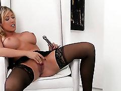 Capri Cavalli with huge boobs and hairless pussy masturbates to orgasm in solo action