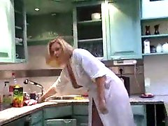 Milf in a robe showing tits in kitchen