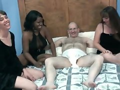 Three ladies blow the dude in a diaper