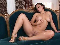Aria Giovanni getting soaked and hot on the ottoman