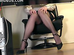 Girl at her desk spreading her legs