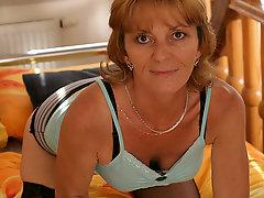 Horny mature slut getting herself wet with her toy