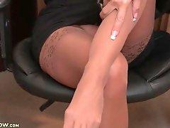 Mature office babe Kasey Storm in pantyhose