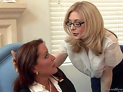 Bespectacled mature lady Nina Hartley is