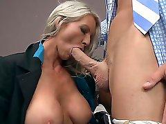 Prepossessing blonde milf pornstar Emma Starr with a appetizing big boobies gets seduced in the office by her attractive boss Johnny Sins. This fellow penetrates her mouth with a huge dick.