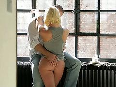 Stunning blonde gives her boyfriend blowjob in the kitchen